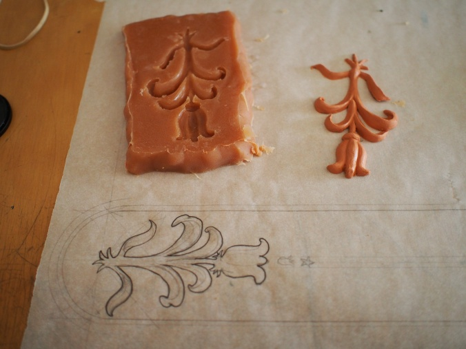 I wanted to do a flower, and so I drew one at scale, sculpted one right over top of my drawing, and then made a mold  of the little guy.