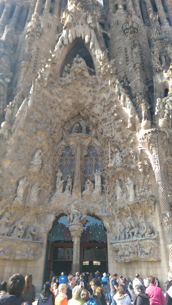 The East façade. Completed while Gaudi was still alive. Notice the florid, ornamented detail. Gaudi pulled his inspiration from nature and it is apparent. At his best, Gaudi's work looks like nature colluding with man to lift architecture from the earth itself.